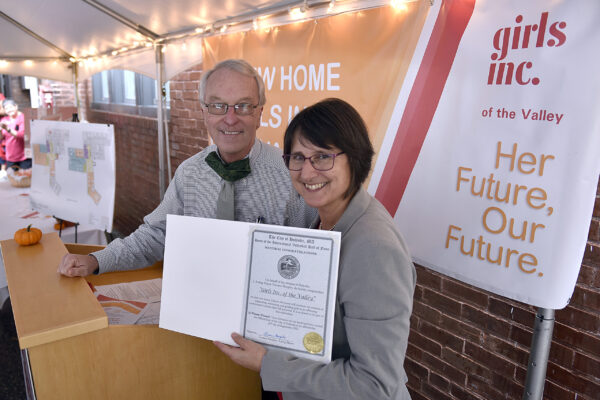 Acting Holyoke Mayor Terrence Murphy and Girls Inc. of The Valley executive director Suzanne Parker with a citation from the city congratulating Girls Inc. on their new two-story, 16,630 headquarters at 480 Hampden Street in Holyoke.  (Don Treeger / The Republican)  9/28/2021